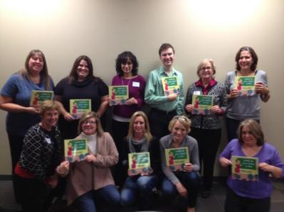 Directors from Child Advocacy Centers in Indiana holding donated copies of WHAT DO YOU WANT TO BE?