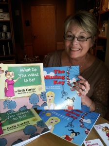 Lisa Slavens, founder of Wish I May, is holding donated copies of my books for underprivileged children. Wish I May provides birthday parties complete with a cake and gifts for the children.