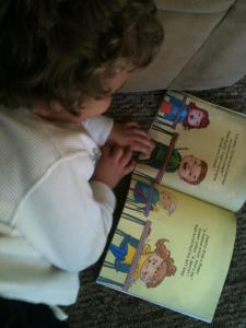 Here's little Logan reading the inside of WHAT DO YOU WANT TO BE?