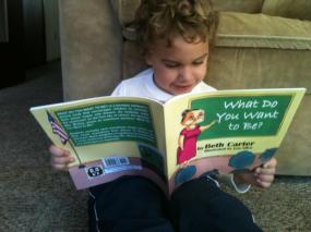 Little Logan reading WHAT DO YOU WANT TO BE?