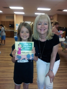 "This precious little girl ran toward me, arms outstretched, and said, ""I LOVE your books!"" She made my month!"
